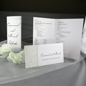 TABMEN09 White diamante invitaton with matching table menus and ceremony programs