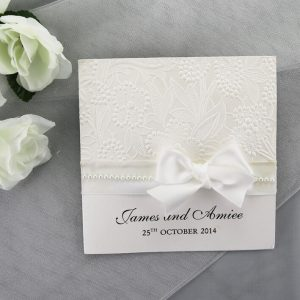 WEDINV154 White Wedding Invitation with White Floral Paper, Ribbon and Pearls