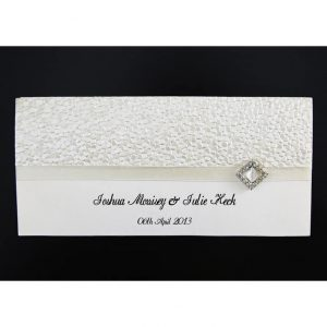 WEDINV11 front of cream wedding invitation with pebbles embossed paper ribbon and diamond diamante