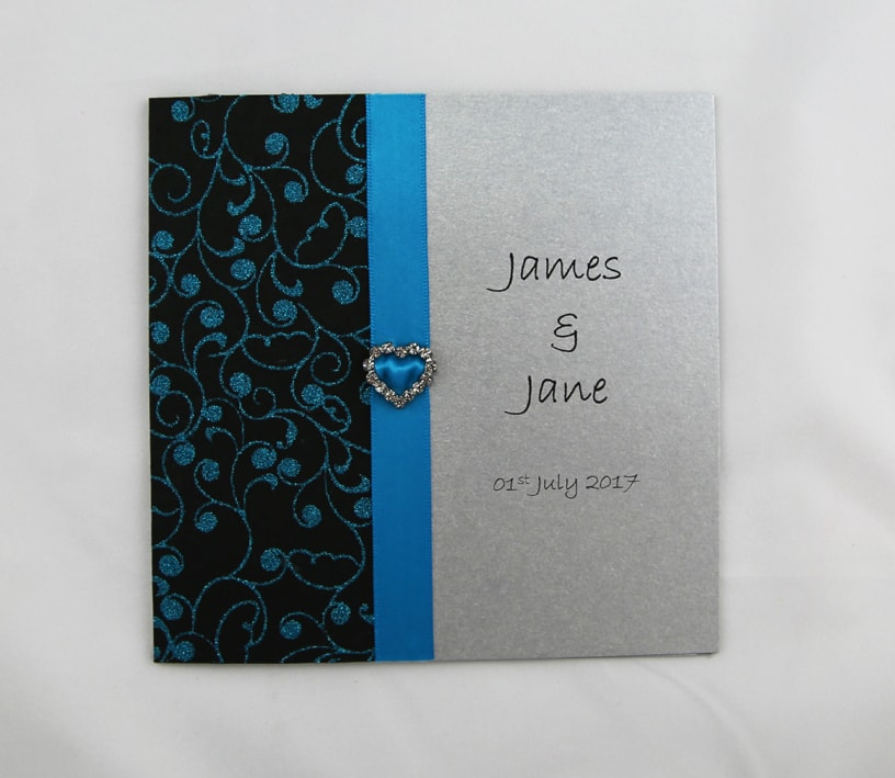 WEDINV119 Silver and blue wedding invitation with heart diamante