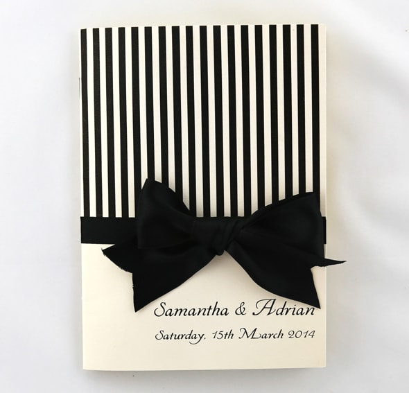 WEDINV141 cream metallic with black stripes and bow cermony book front