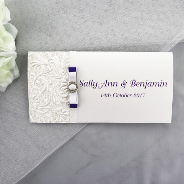 WEDINV128 Embossed Floral White and Purple Wedding Invitation with Ribbon and Diamante