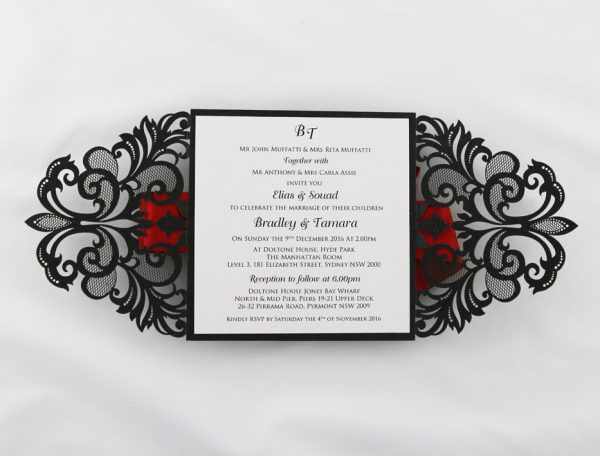 WEDINV130 Inside of black lasercut invitation with red ribbon and white insert