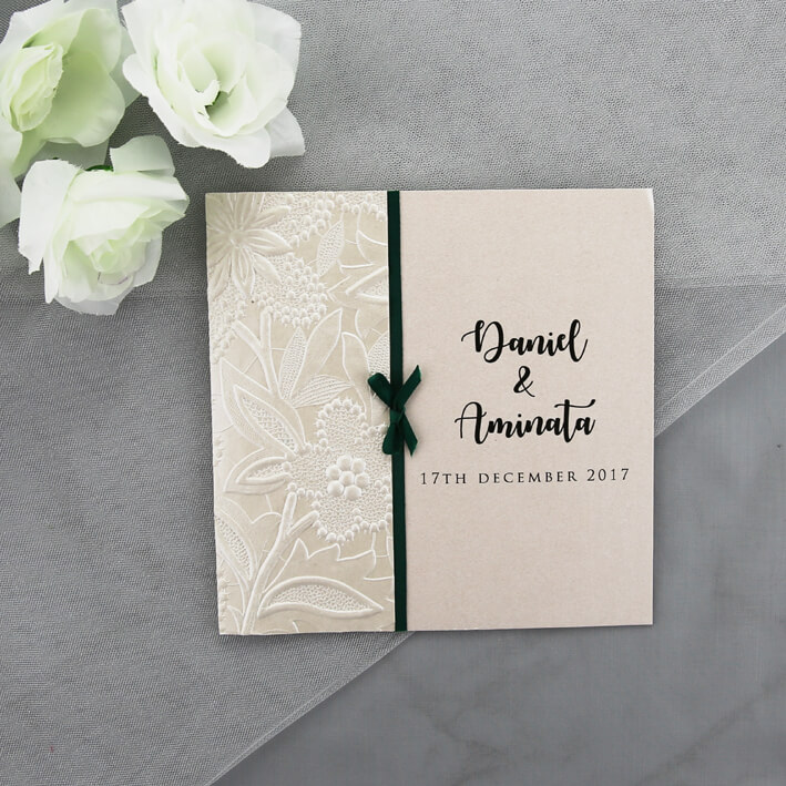 Ivory Wedding Invitation With Floral Embossed Paper And Green Ribbon