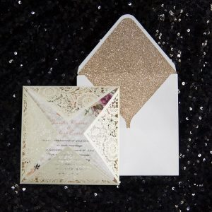 WEDINV148 Ivory lasercut wedding invitation with floral insert and white envelope with gold glitter liner