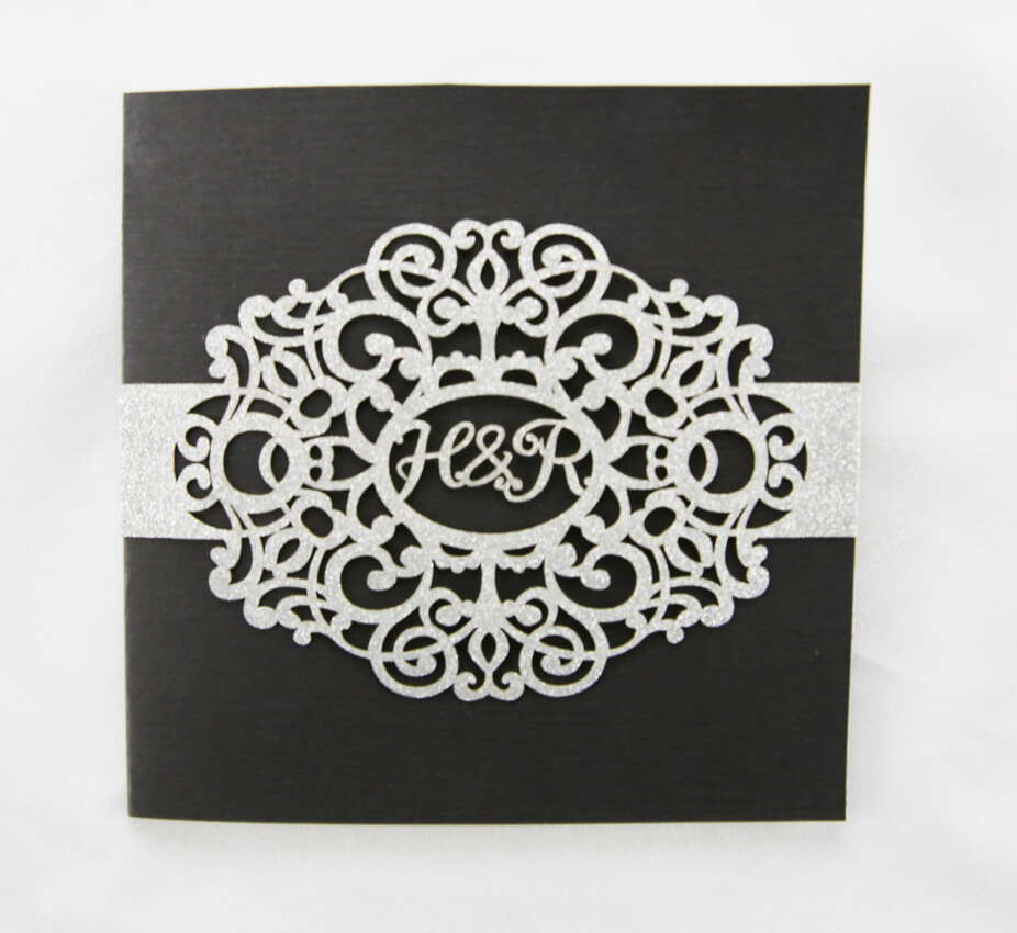 WEDINV20 front of black and silver laser initals wedding invitation
