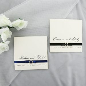 WEDINV122 Textured Wedding Invitation with black and navy Ribbon, Bow and Diamante