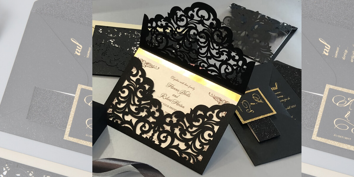 Black lasercut with gold foil wedding invitation