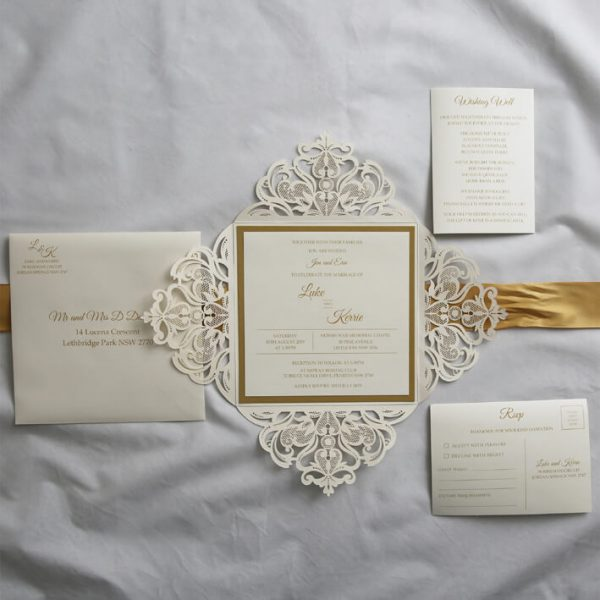 WEDINV187 inside of Ivory lasecut wedding invitation with gold ribbon