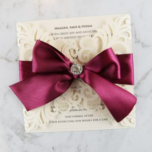 WEDINV188 Ivory lasecut wedding invitation with burgundy ribbon and diamante 300x300