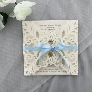WEDINV188 ivory lasercut invitation with baby blue bow and printed in grey