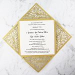 WEDINV194 insside of metallic gold lasercut filigree card with ivory insert