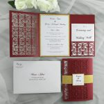 WEDINV198 burgundy lasercut invitation with gold glitter and pocket