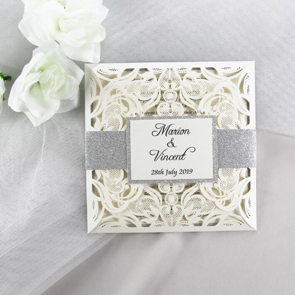 WEDINV200 ivory and silver glitter lasercut wedding invitation with belly band