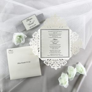 WEDINV200 ivory and silver glitter lasercut wedding invitation with belly band set